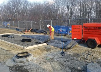 Crew-preparing-to-install-concrete-pad-to-house-access-covers-for-tank-electronic-monitoring-system-pump-out-spill-bucket-and-manway-risers-350x250.jpg